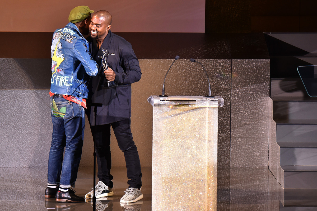 Kanye West presenting Pharrell with the fashion icon award at the 2015 CFDA Fashion Awards. Photo: Michael Loccisano/Getty Images