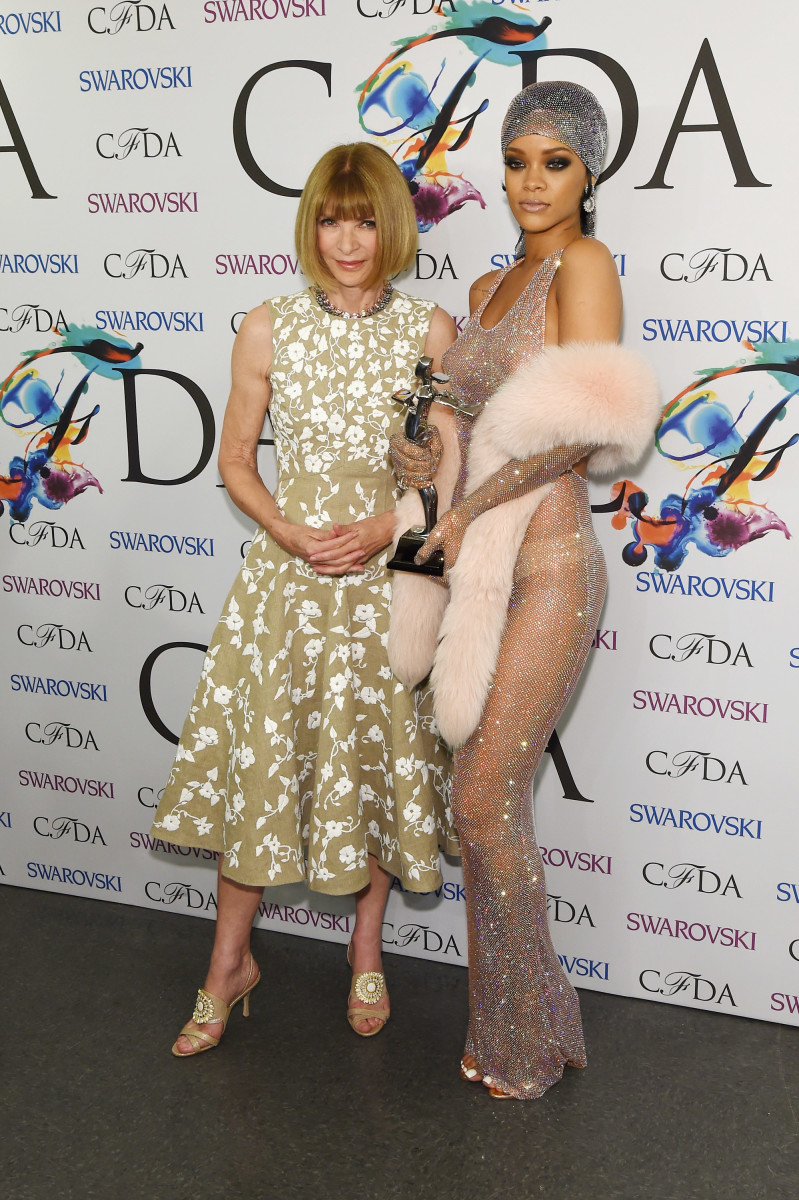 """Rihanna wearing """"crazy shit"""" (by Adam Selman) at the 2014 CFDA Awards with Anna Wintour. Photo: Larry Busacca/Getty Images"""