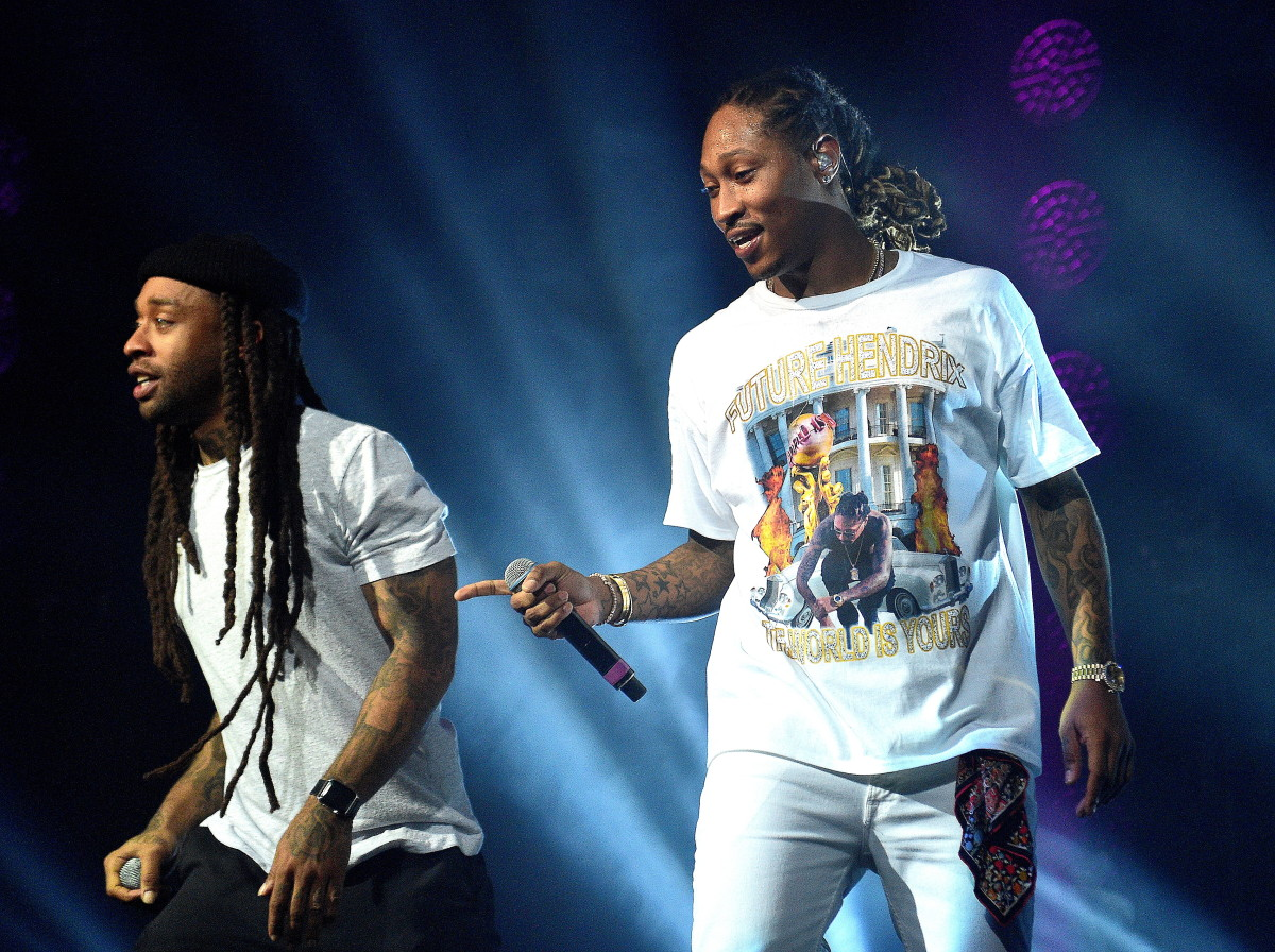"Future, performing with Ty Dolla Sign, in a ""Purple Reign"" tour T-shirt designed by Dbruze. Photo: Prince Williams/WireImage"