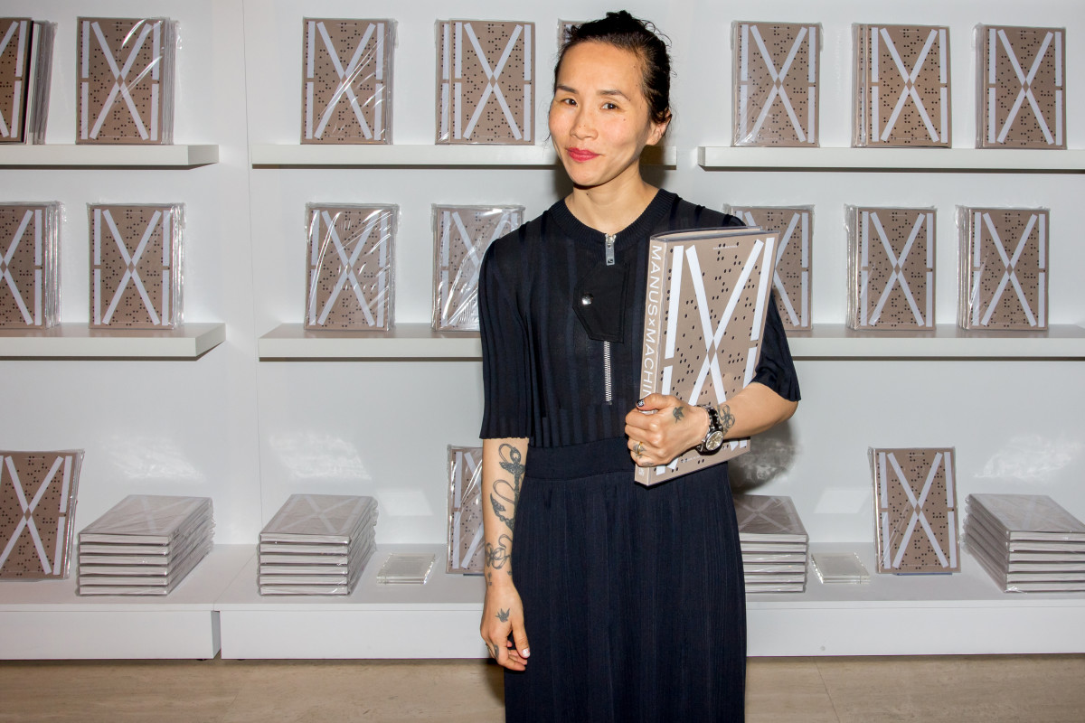 "Olivia Kim with ""Manus x Machina"" catalogues. Photo: The Met Store"