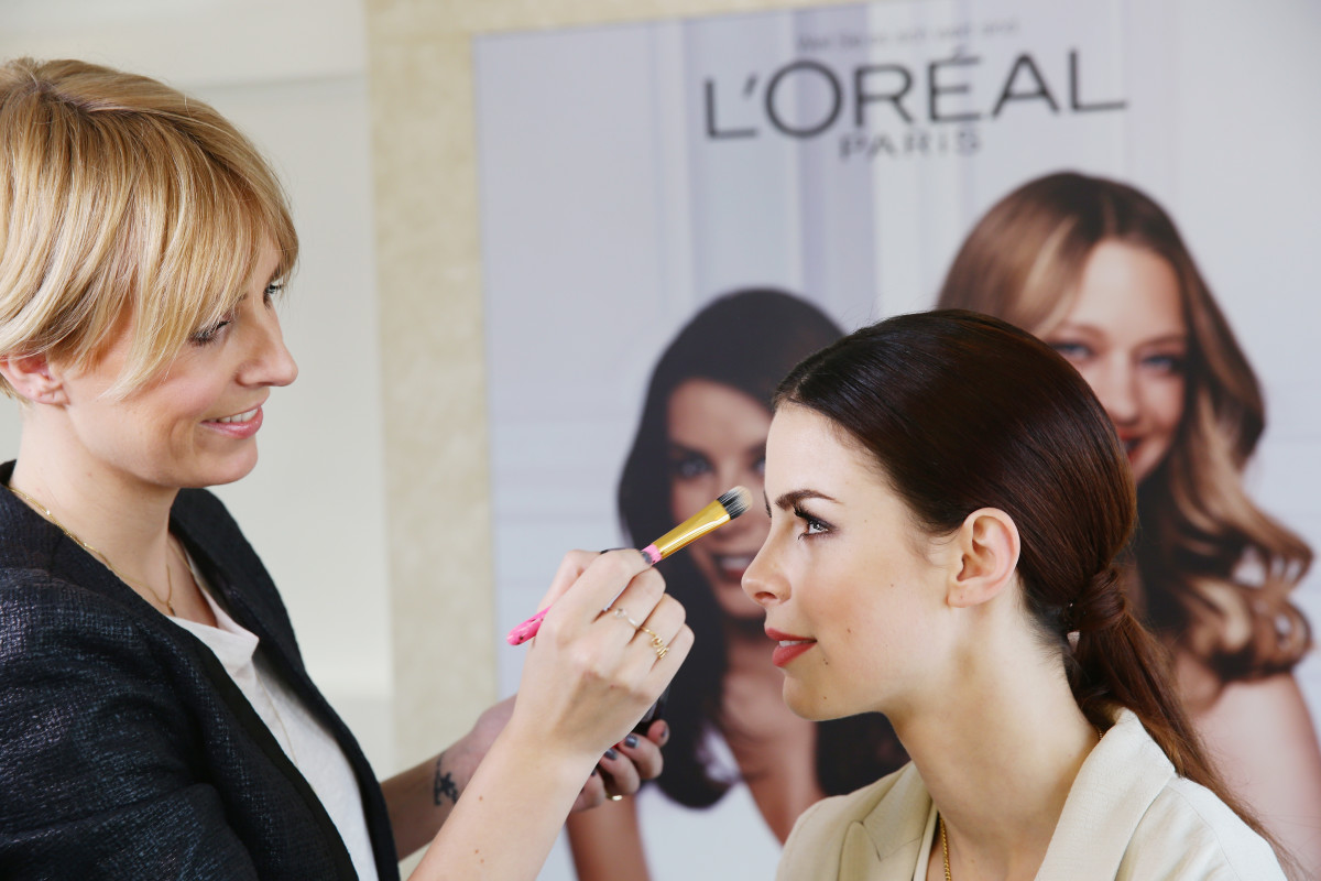 Singer Lena-Meyer Landrut with a L'Oreal makeup artist. Photo: Vittorio Zunino Celotto/Getty Images