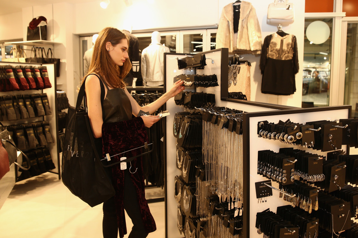 A shopper peruses the jewelry section at Forever 21. Photo: Cameron Spencer/Getty Images
