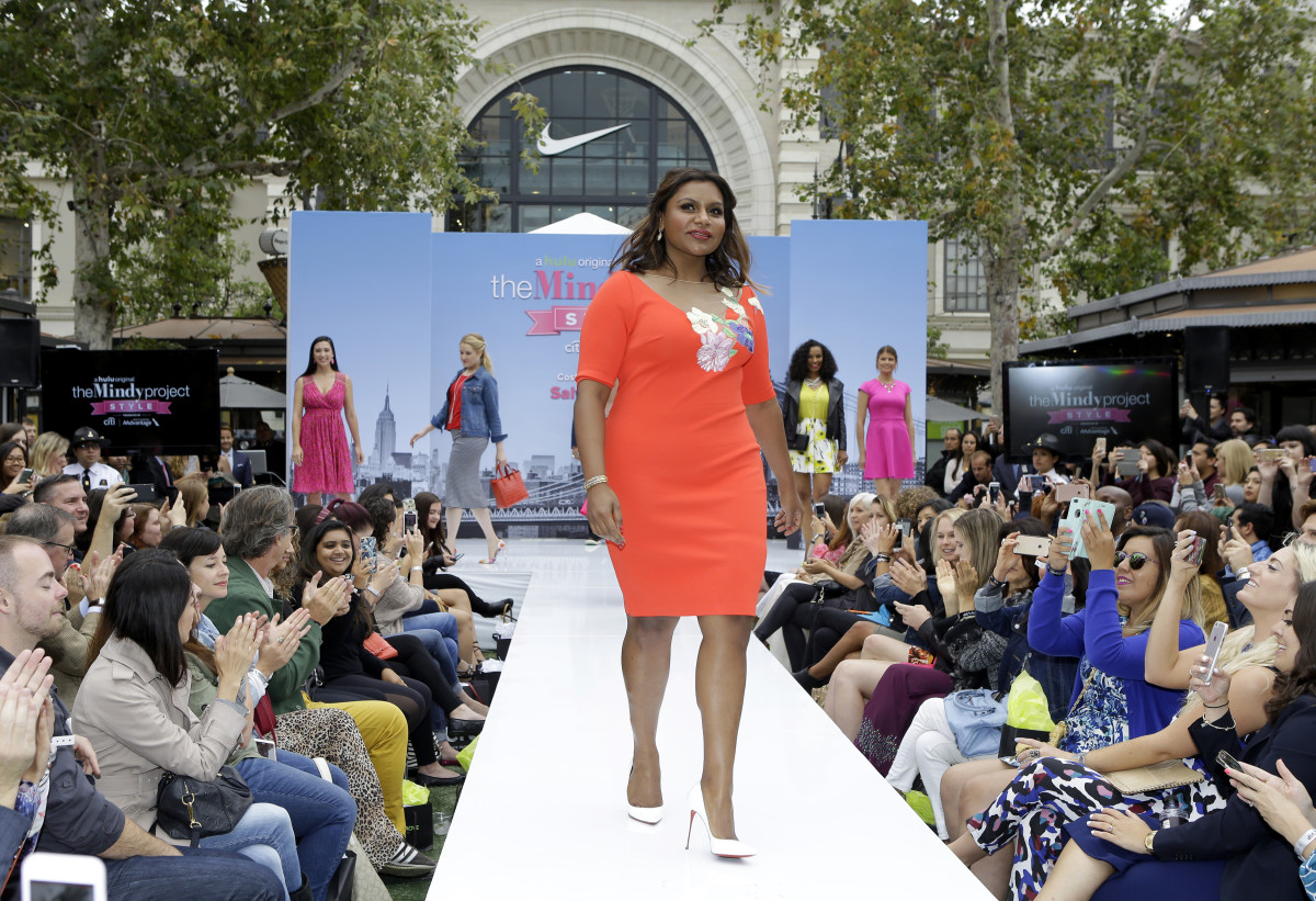 """Mindy Kaling walks the runway at """"The Mindy Project Style"""" fashion show at The Grove in Los Angeles. Photo: Getty Images for Caruso Affiliat"""