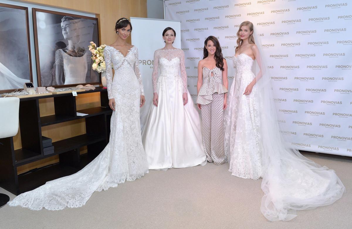 Stylist Micaela Erlanger with model brides at the Pronovias flagship boutique in New York. Photo: Pronovias