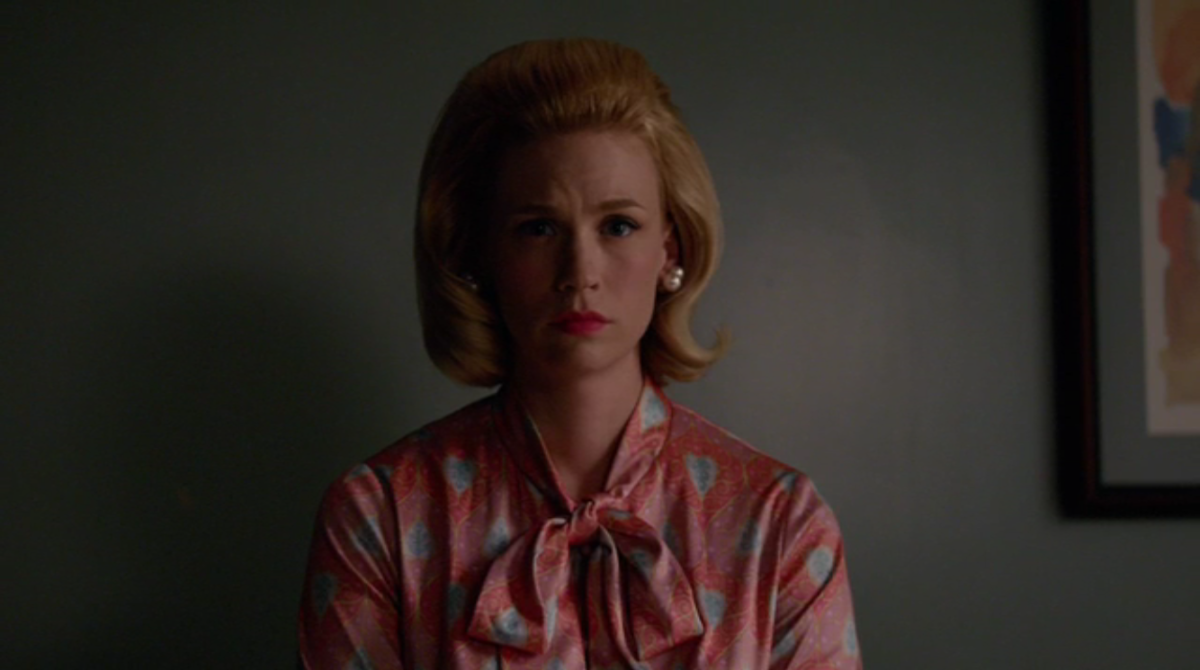 Betty listens as men talk about her health. Screengrab: AMC