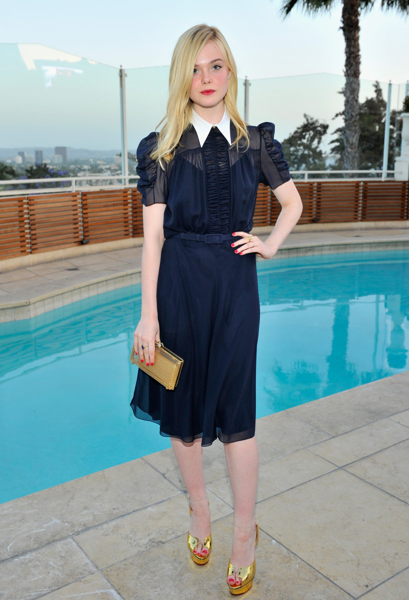 Elle Fanning takes pool parties seriously. Photo: Donato Sardella/Getty Images for Charlotte Olympia