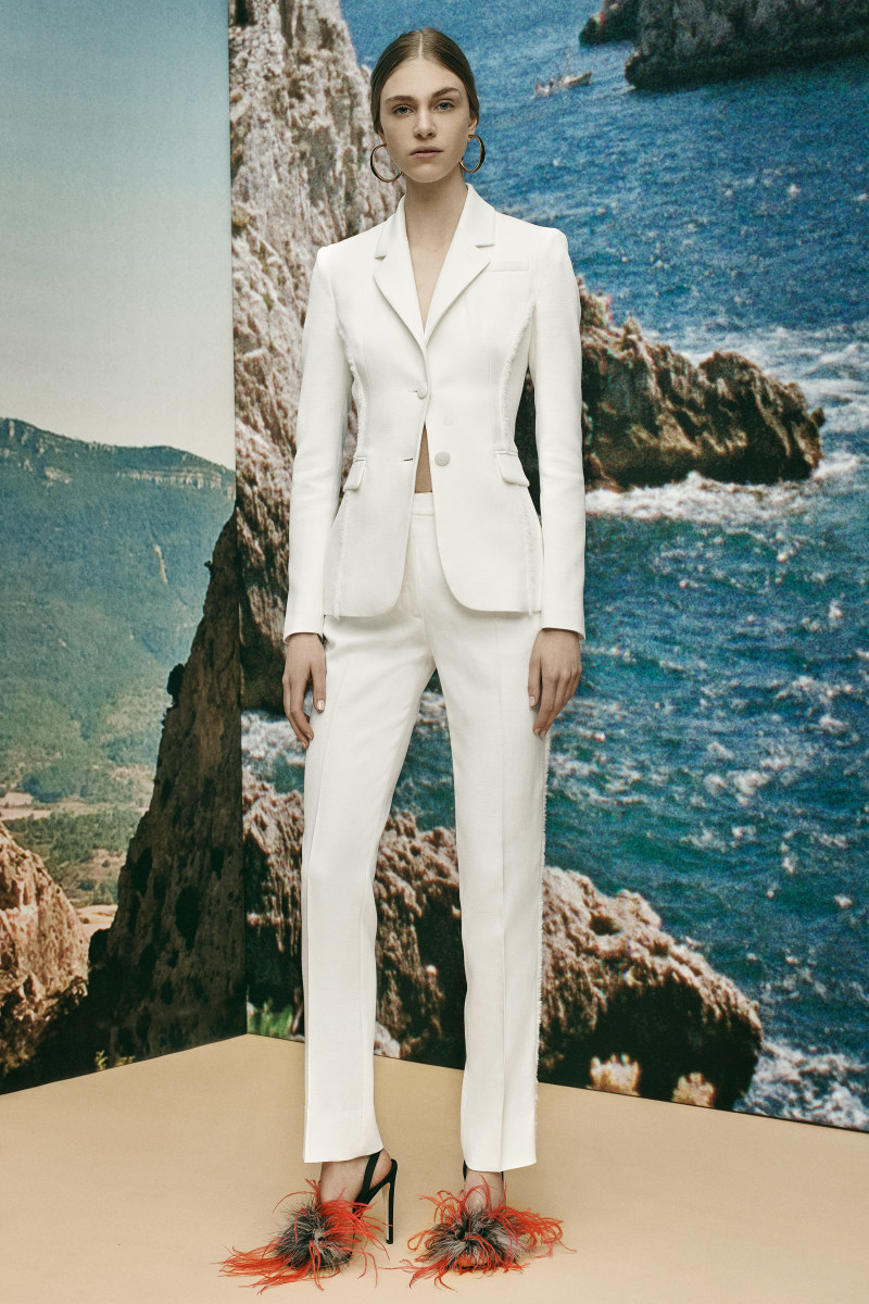 A white pantsuit with frayed seam details from Joseph Altuzarra's resort 2016 collection.