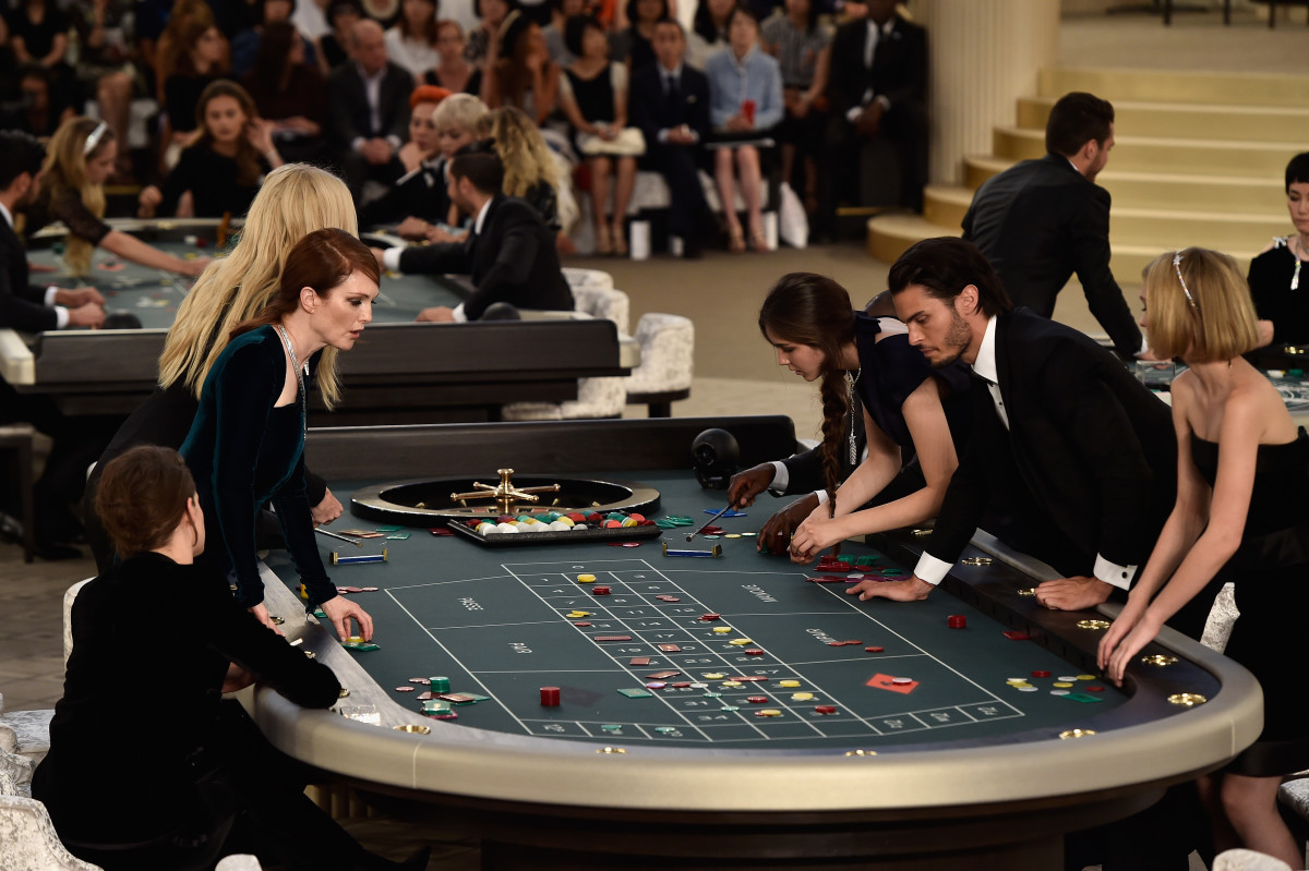 Kristen Stewart, Julianne Moore, Lara Stone, Baptiste Giabiconi and Lily-Rose Depp at the Chanel roulette table. Photo: Pascal Le Segretain/Getty Images