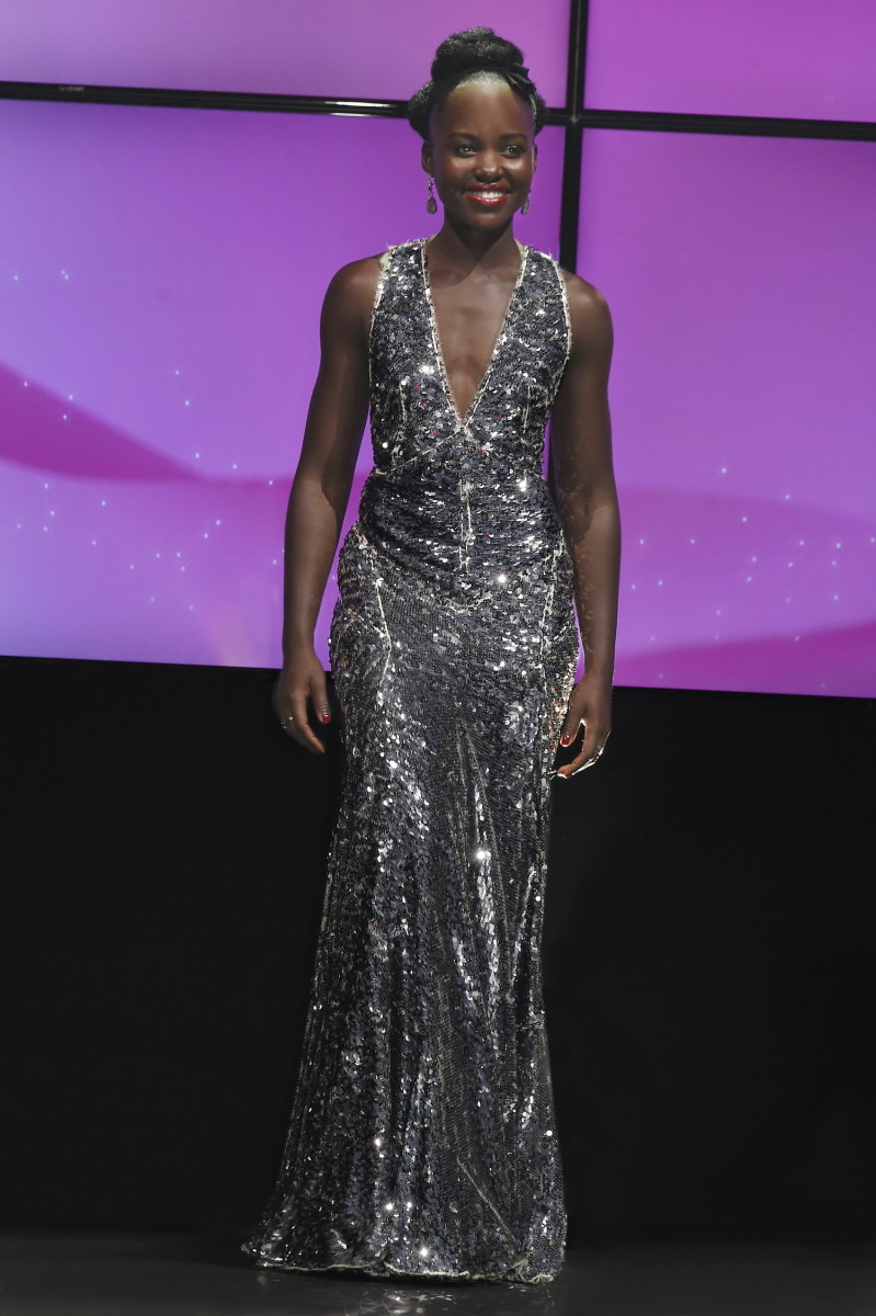 Lupita Nyong'o on stage at Lancôme's 80th anniversary celebration. Photo: Prada