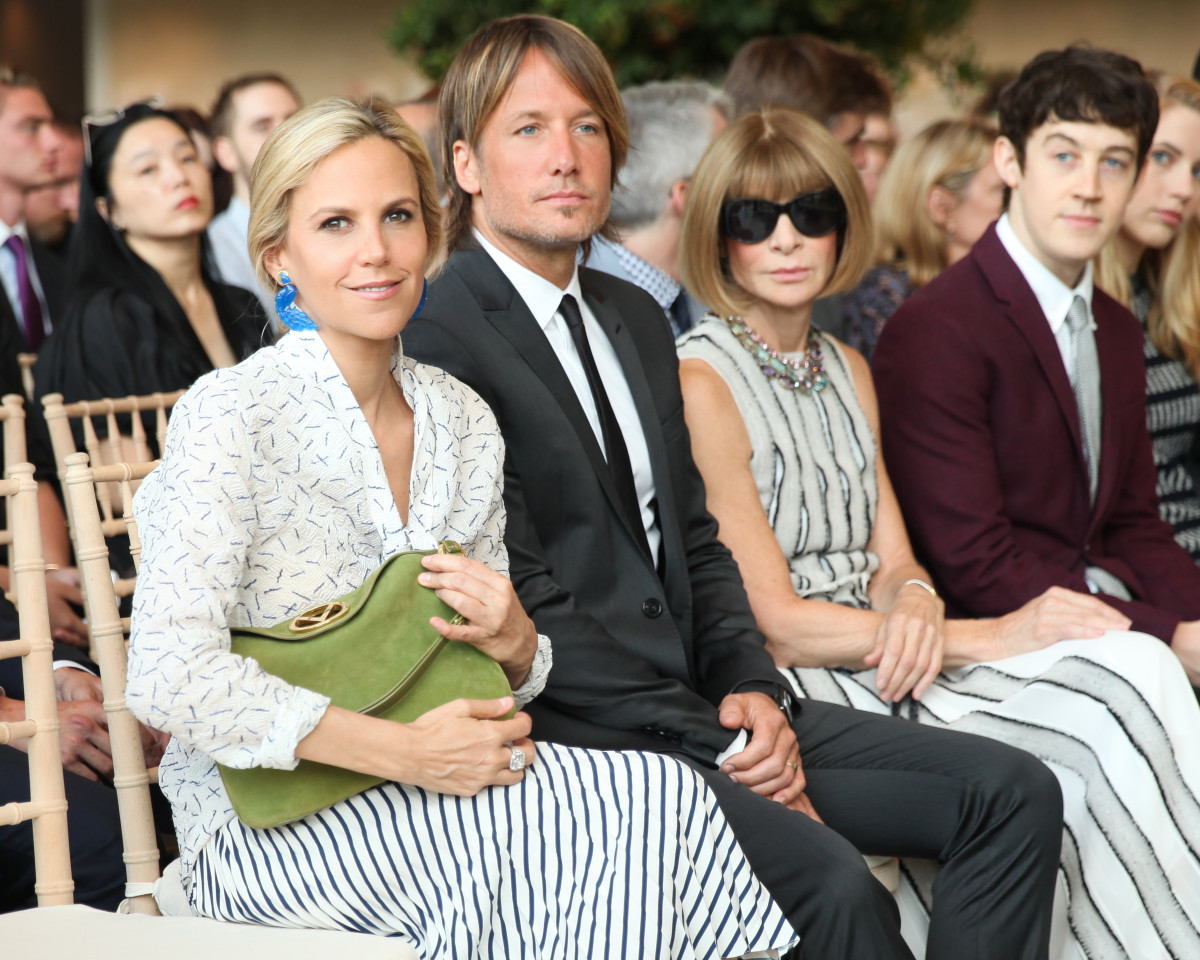 Tory Burch, Keith Urban and event co-host Anna Wintour sit FROW. Photo: Vogue