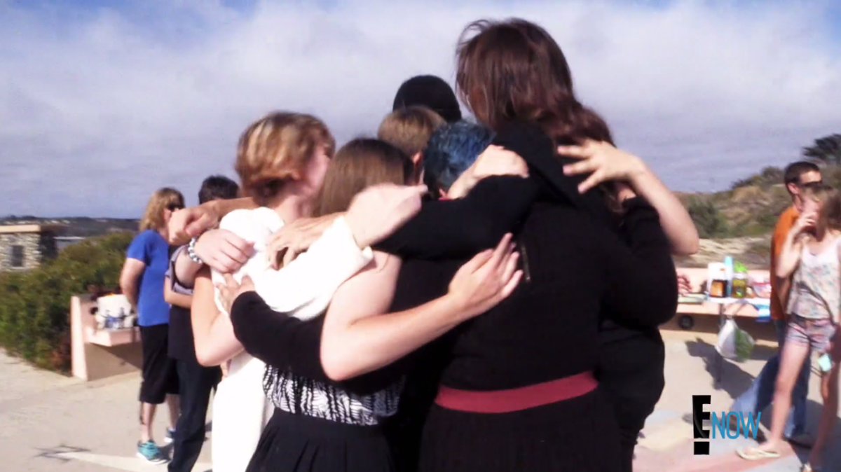 Jenner in a group hug at Kyler Prescott's memorial service. Screengrab: E!