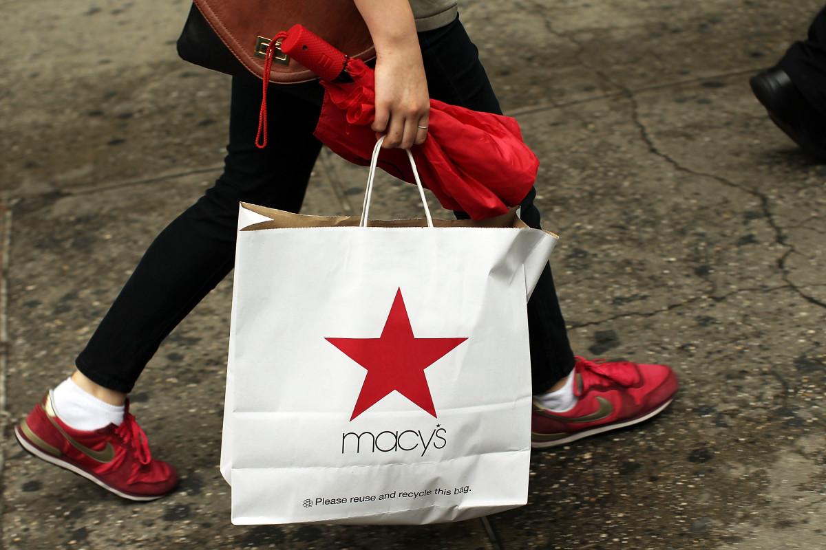A Macy's shopper hits the street. Photo: Spencer Platt/Getty Images