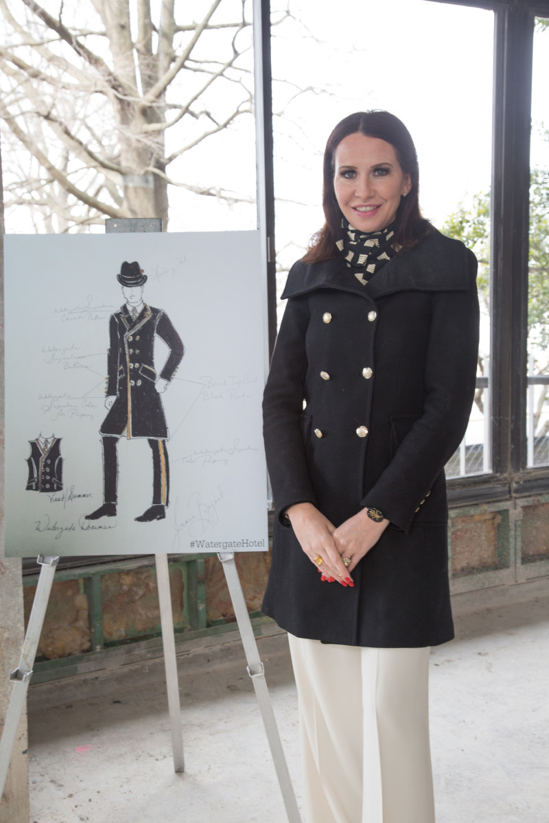 Janie Bryant next to a sketch of one of her uniform designs for The Watergate Hotel. Photo: Janie Bryant
