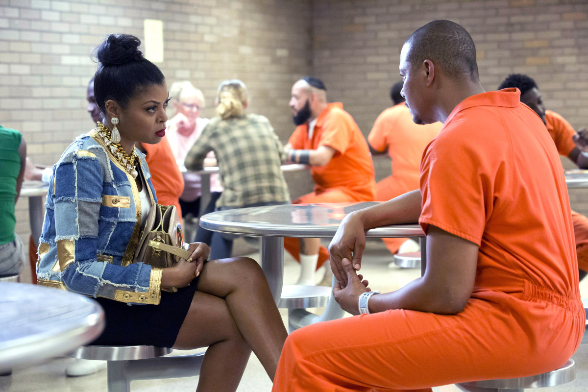 Taraji P. Henson as Cookie Lyon (in a Moschino jacket, Kenneth Jay Lane jewelry with a Christian Louboutin bag) and Terrence Howard as Lucious Lyon (in a jumpsuit from the New York State Department of Correctional Services). Photo: Chuck Hodes/FOX
