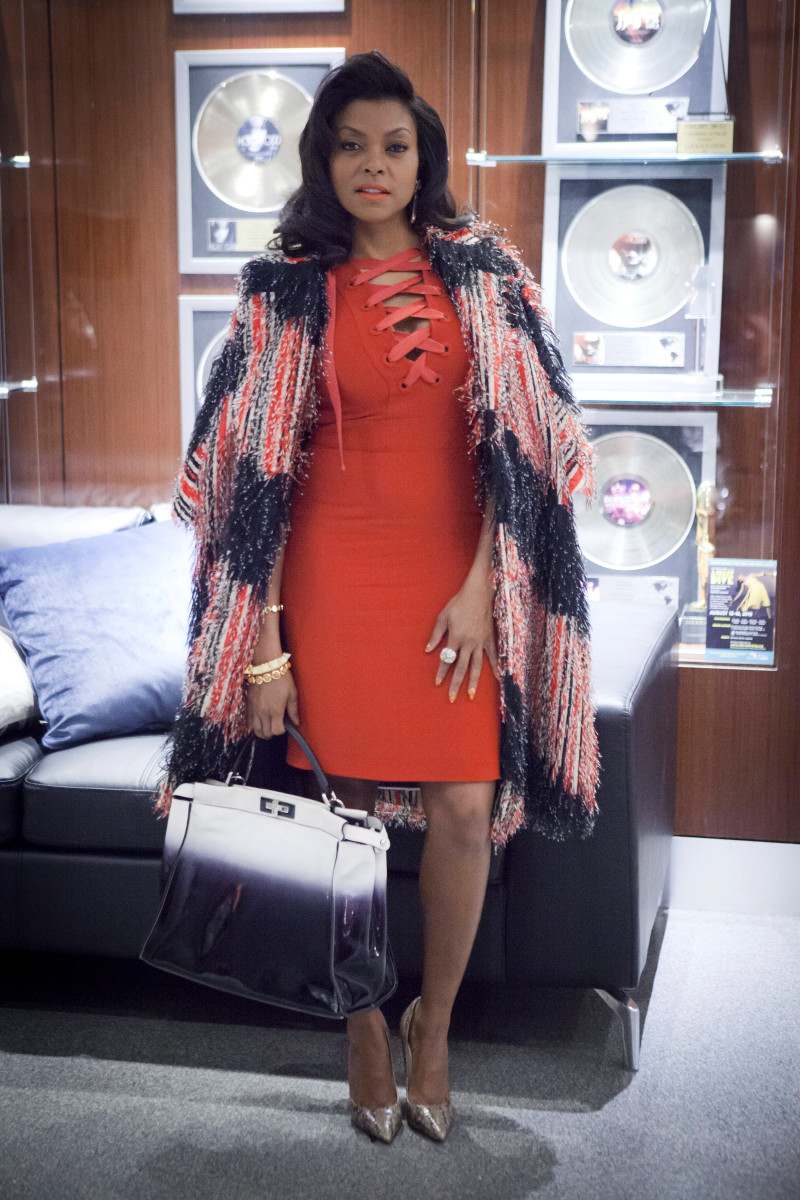 CEO Cookie wears a Gucci dress, Fendi coat and bag, Jimmy Choo heels and Eddie Borgo bracelets.  Photo: Chuck Hodes/FOX