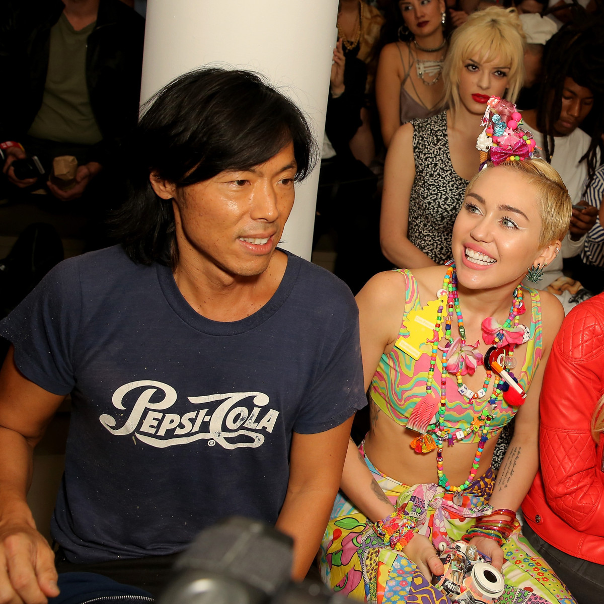 Stephen Gan with Miley Cyrus in 2014. Photo: Chelsea Lauren/Getty Images