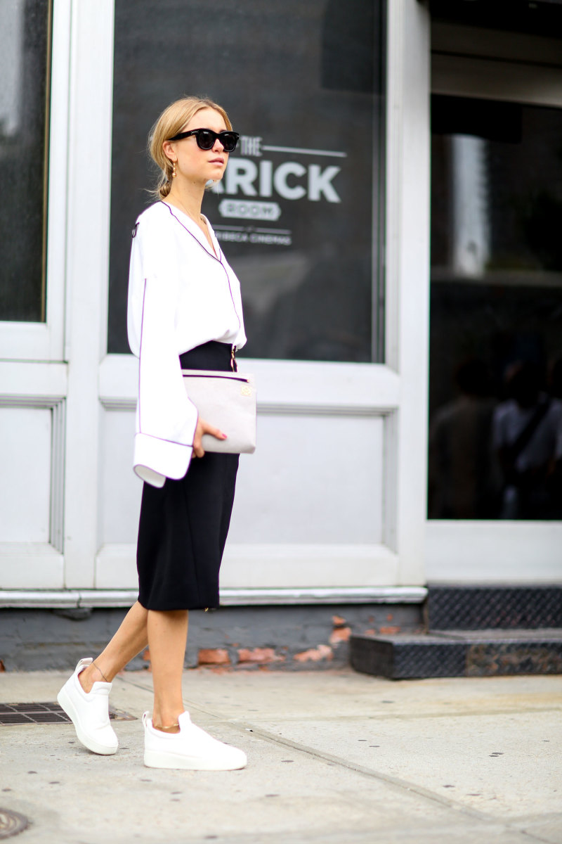 Blogger Pernille Teisbaek in Altewaisaome blouse and Loewe clutch. Photo: Imaxtree