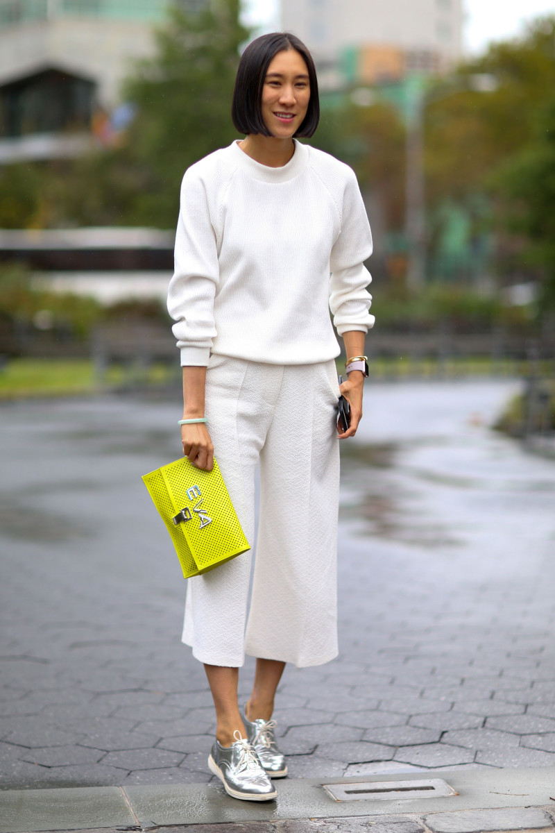 Eva Chen in Atea Oceanie sweater and pants, Cole Haan shoes and Proenza Schouler bag. Photo: Imaxtree