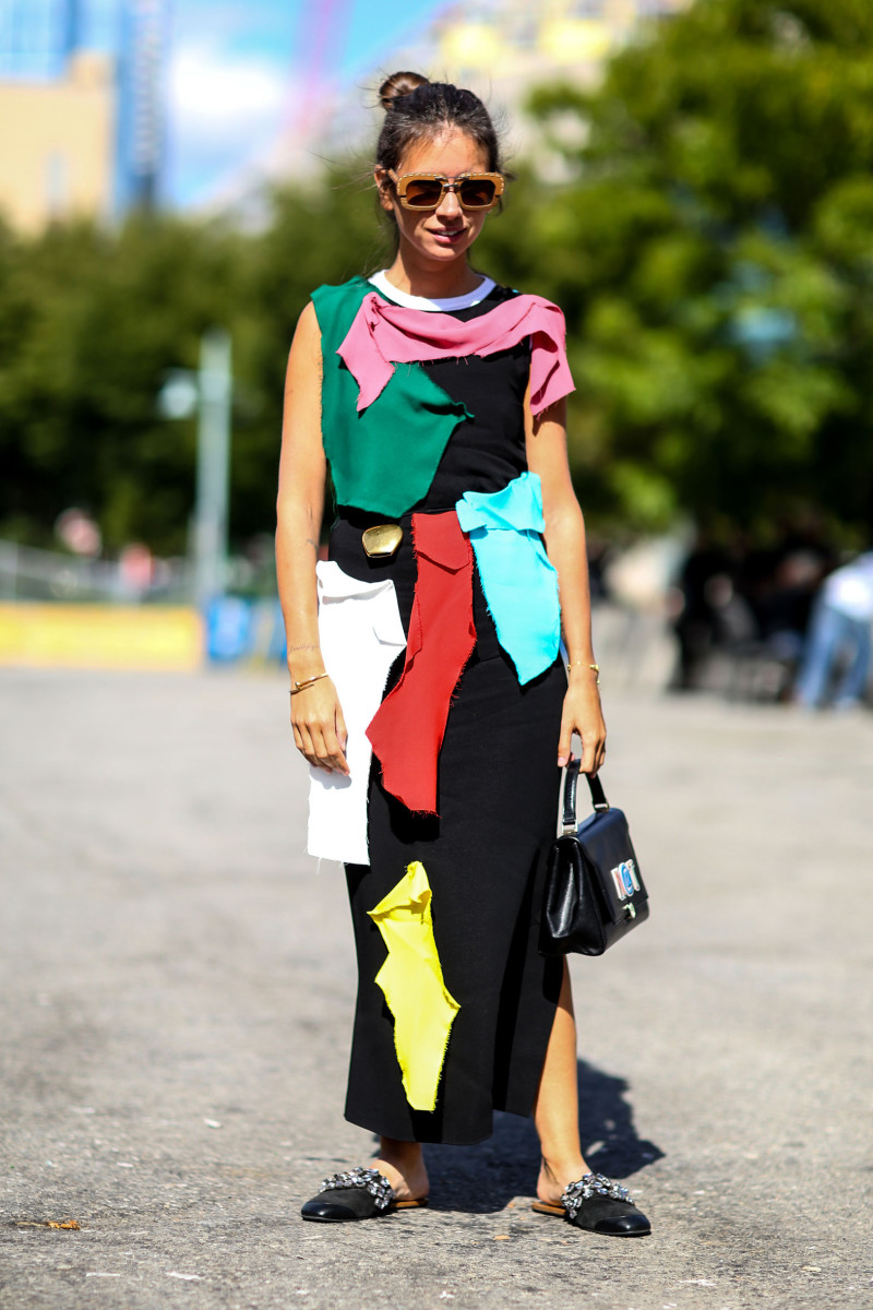 Designer/stylist Natasha Goldenberg in Loewe with Anya Hindmarch bag. Photo: Imaxtree