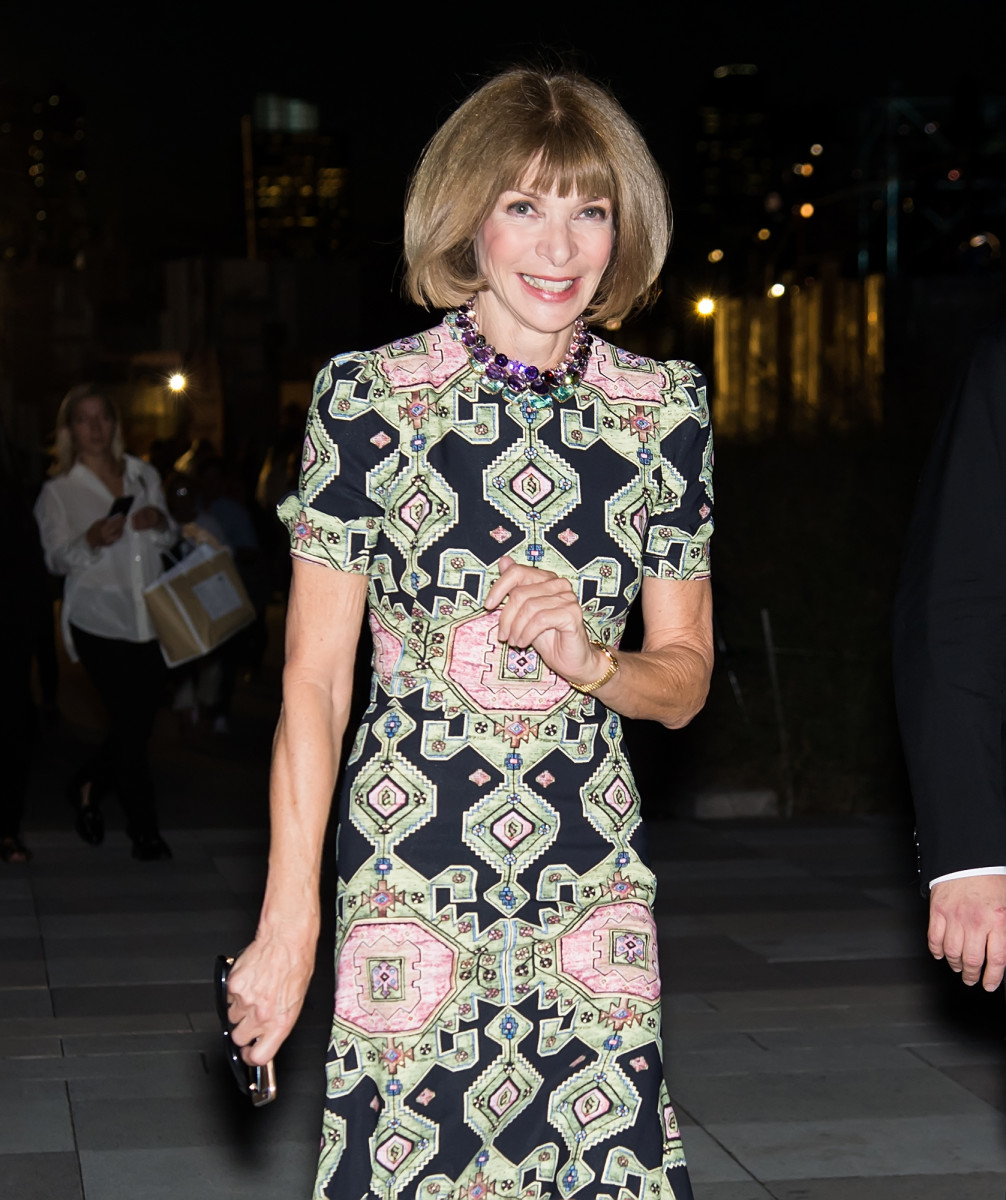 A cheery Anna Wintour heading into the Givenchy show. Photo: Gilbert Carrasquillo/Getty Images