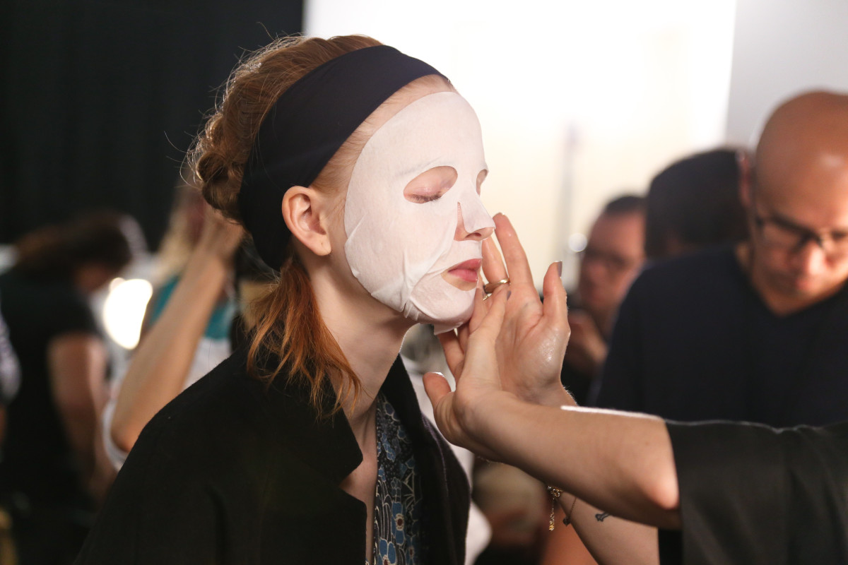 A model wearing a Dr. Jart+ mask backstage at Suno. Photo: Anna Webber/Getty Images