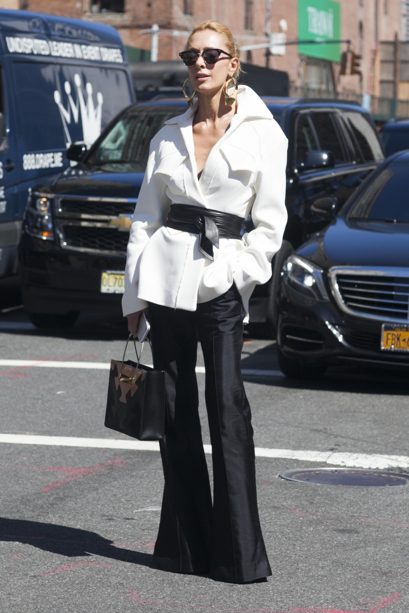 Stylist Elina Halimi in Ellery jacket, pants and Balenciaga bag. Photo: Emily Malan/Fashionista