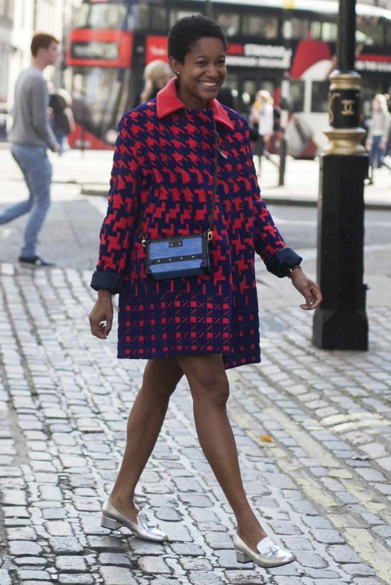Tamu McPherson in a Mary Katrantzou coat and Louis Vuitton bag. Photo: Emily Malan/Fashionista