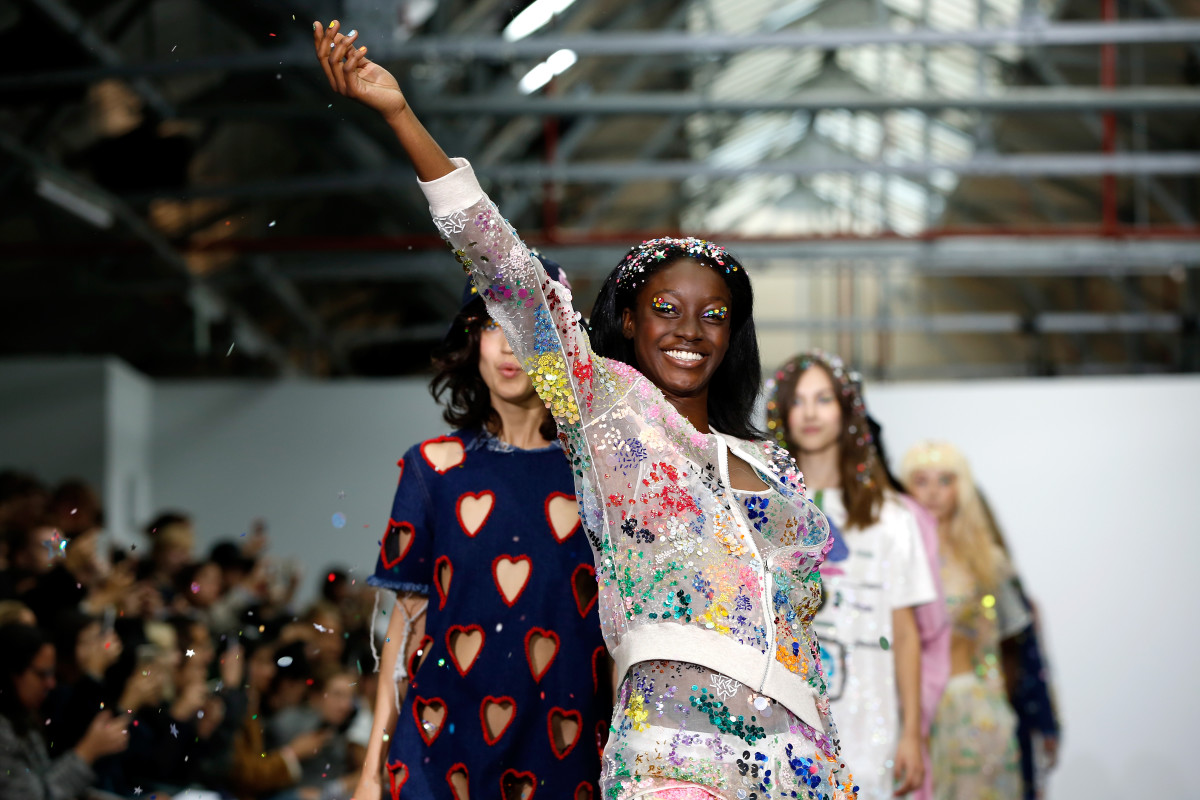 A model tosses glitter at Ashish's show on Tuesday. Photo: John Phillips/Getty Images