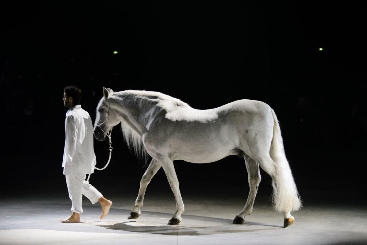 Designer Simon Porte Jacquemus leading a horse across his show space on Tuesday. Photo: Imaxtree