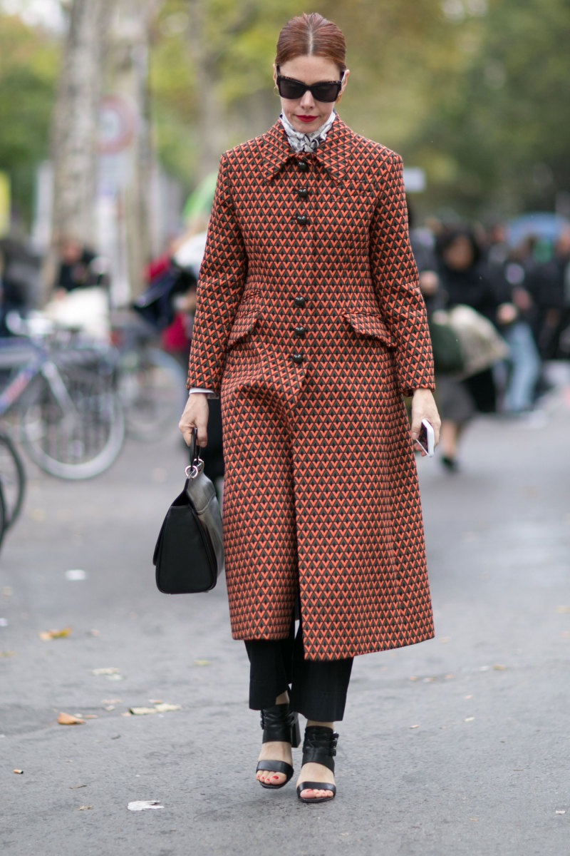 Refinery29's Christene Barberich in Prada coat, & Other Stories bag and Zara shoes. Photo: Imaxtree