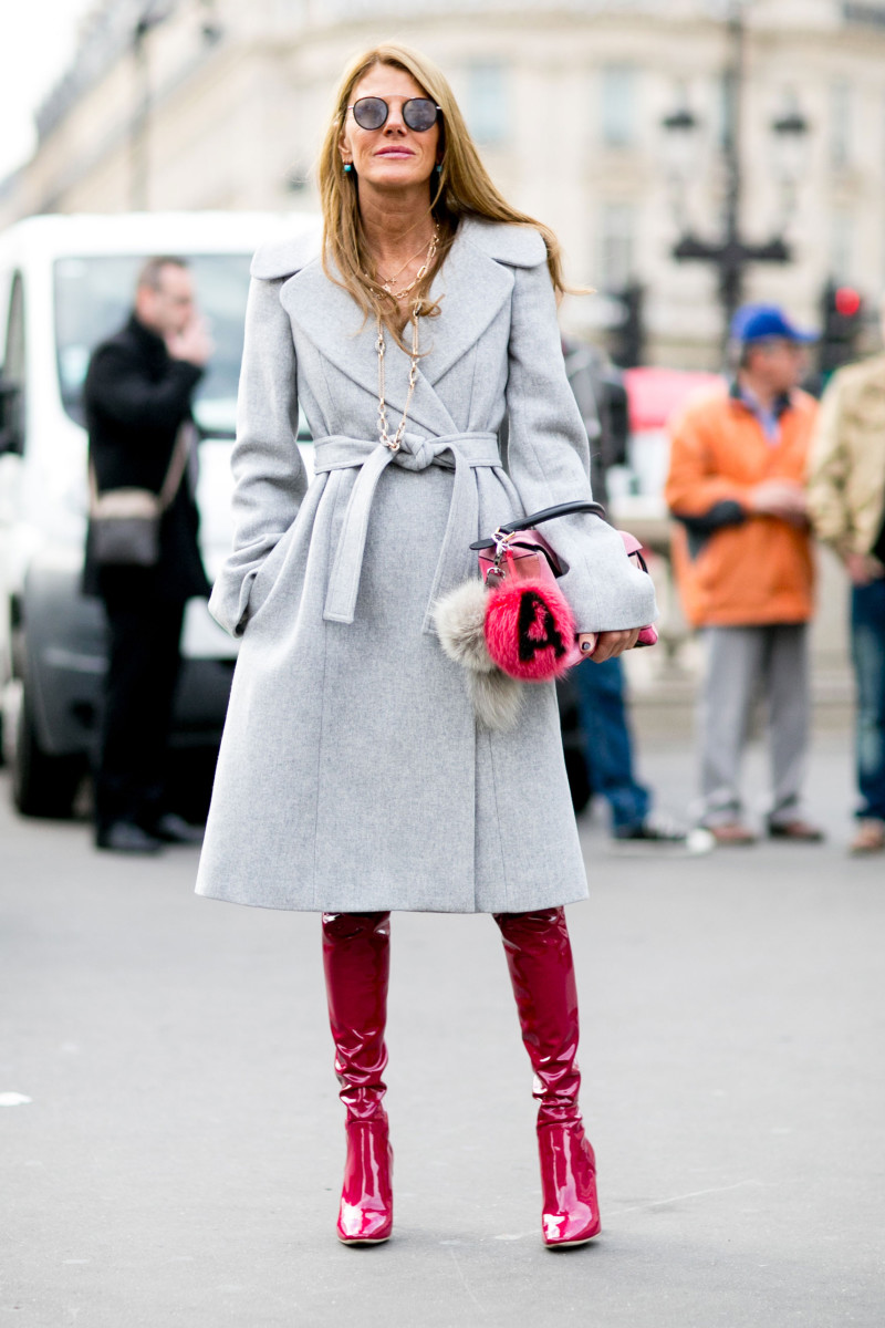 Anna Dello Russo in Stella McCartney coat, Dior boots, Loewe bag and Fendi charm. Photo: Imaxtree