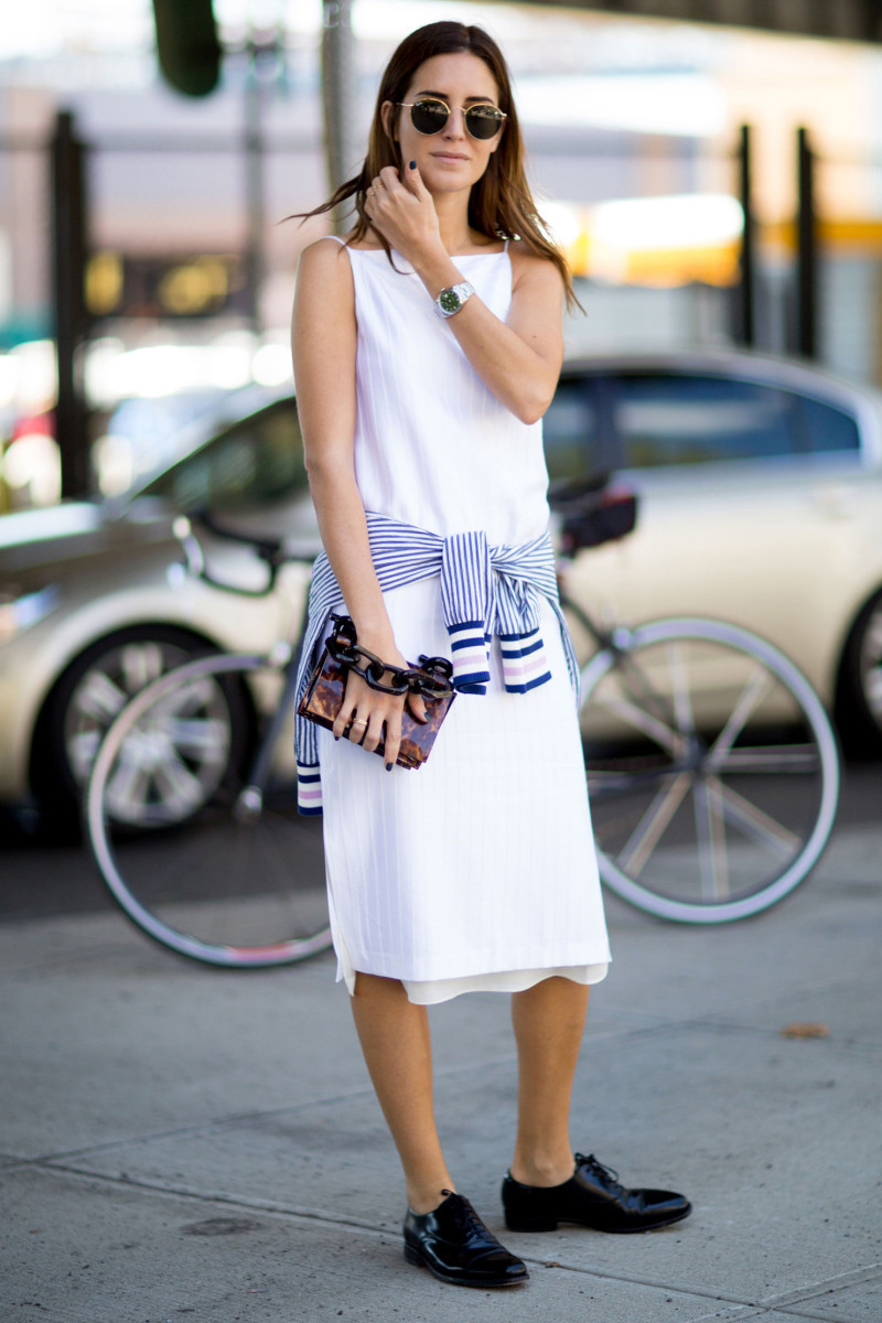 Blogger Gala Gonzalez at New York Fashion Week in an Edun dress, Carolina Herrera shoes, Calvin Klein bag and Tommy Hilfiger jacket. Photo: Imaxtree