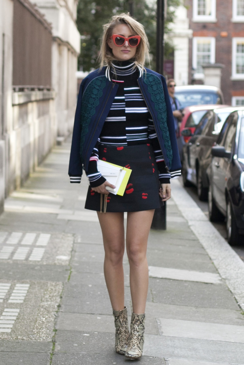 Blogger Rebecca Laurey at London Fashion Week in a Kenzo sweater, Self Portrait jacket, Neil Barrett skirt, Jimmy Choo bag, Isabel Marant boots and Stella McCartney sunglasses. Photo: Emily Malan/Fashionista