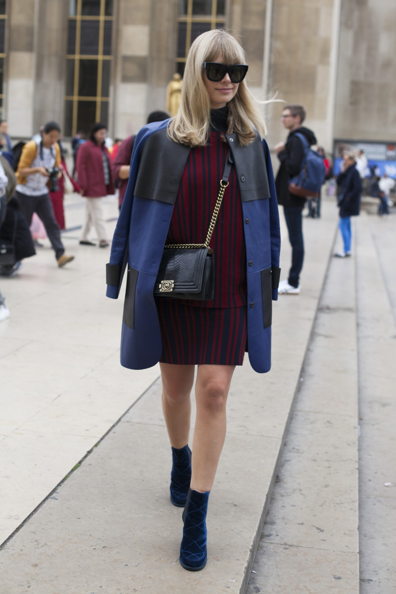 Footwear News Fashion Director Mosha Lundstrom Halbert at Paris Fashion Week in a Tanya Taylor knit, Longchamp jacket and Laurence Dacade boots. Photo: Emily Malan/Fashionista