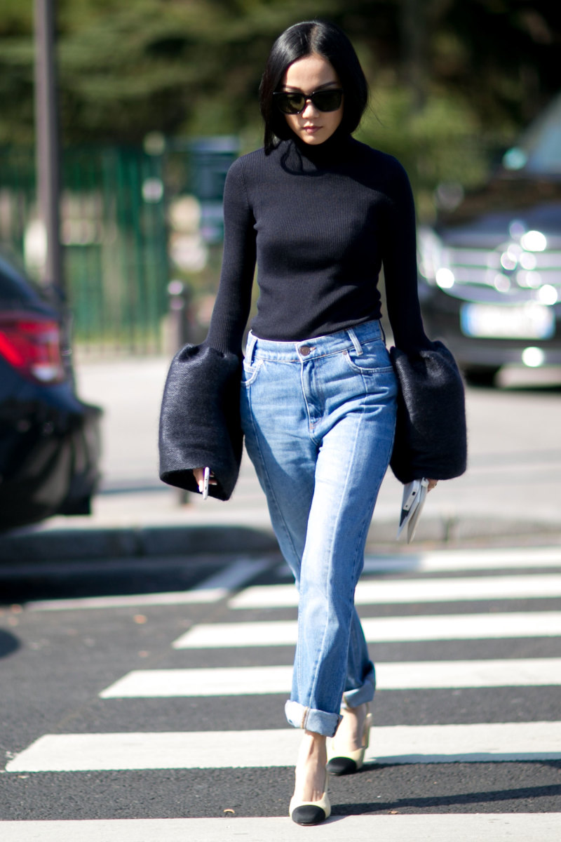 Blogger Yoyo Cao at Paris Fashion Week in a Celine top, Sandro jeans and Chanel slingbacks. Photo: Imaxtree