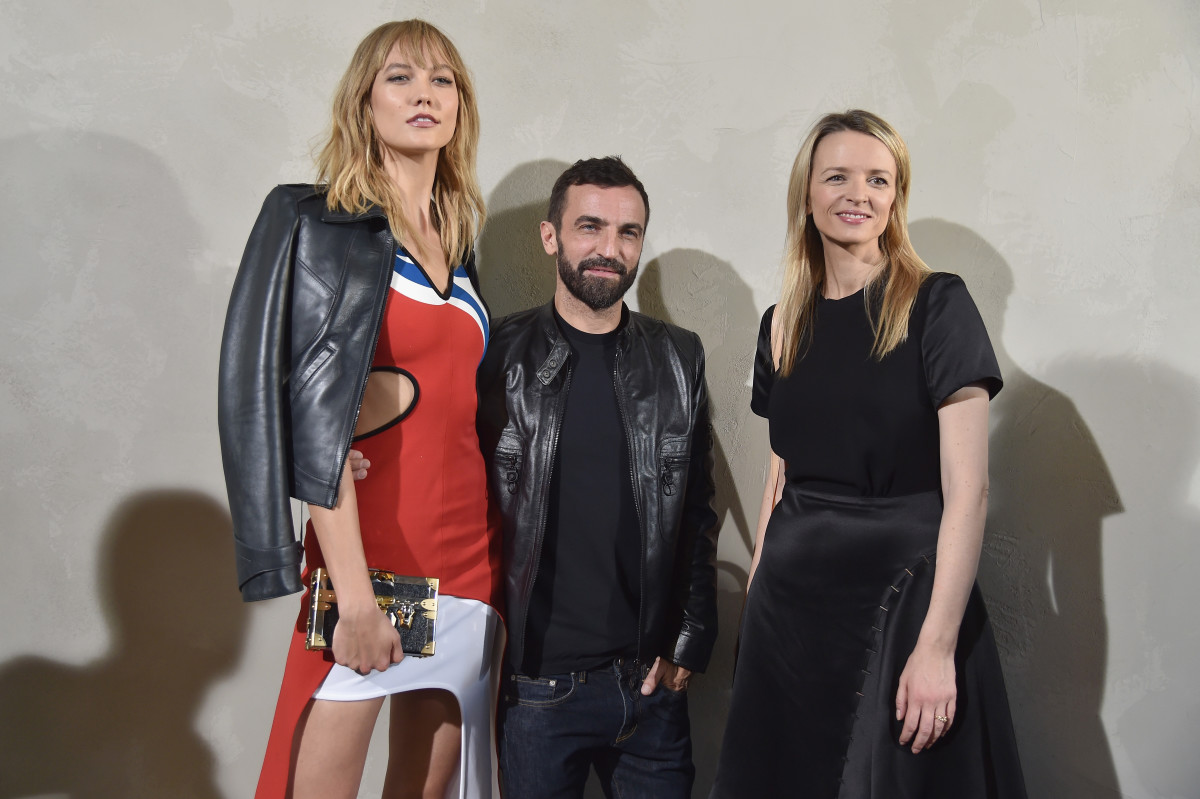 Karlie Kloss, Nicolas Ghesquière and Delphine Arnault attend the spring 2017 Louis Vuitton show in Paris. Photo: Pascal Le Segretain/Getty Images