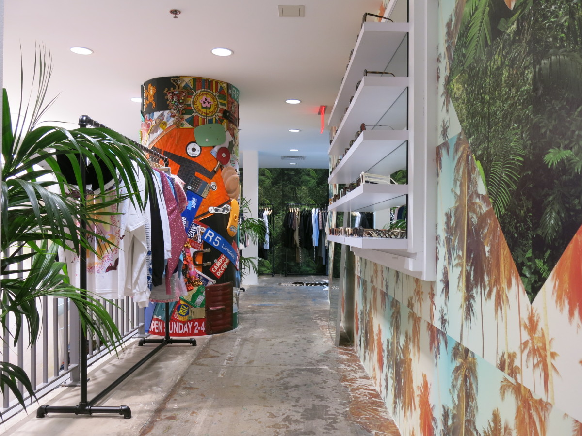 Emerging designers space and sunglasses wall. Photo: Dover Street Market New York
