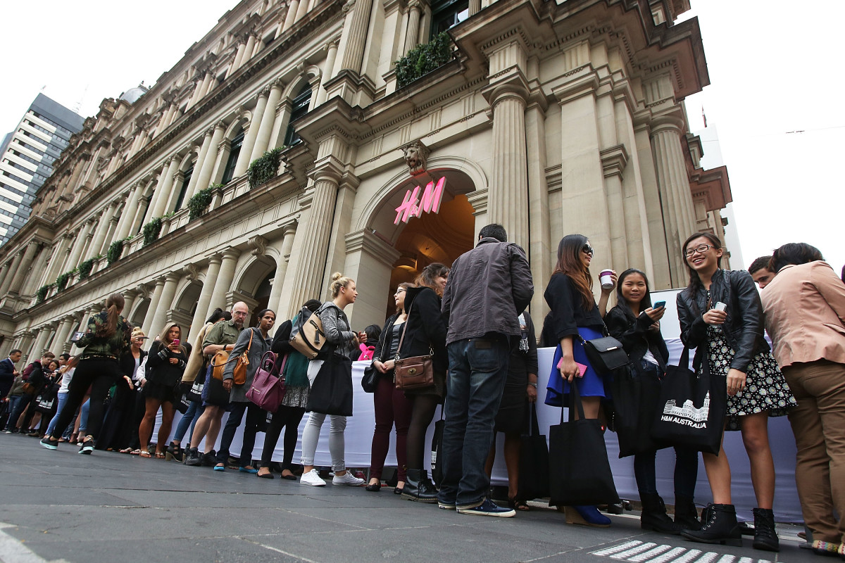 Shoppers wait in line at an H&M store opening in Melbourne. Photo: Graham Denholm/Getty Images