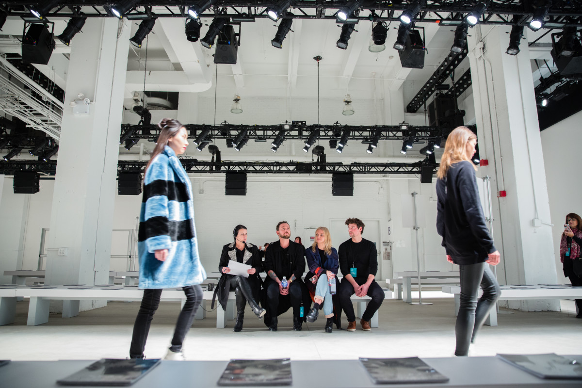 Laurie DeJong (seated, left) and her team run through the Marcel Ostertag fall 2016 NYFW runway show. Photo: LDJ Productions