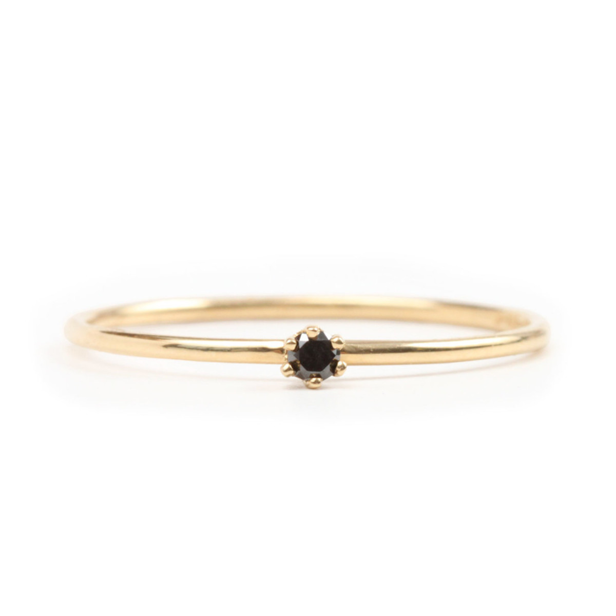 Satomi Kawakita The Tiniest Ring, Black Diamond, $210, available atundefinedCatbird.