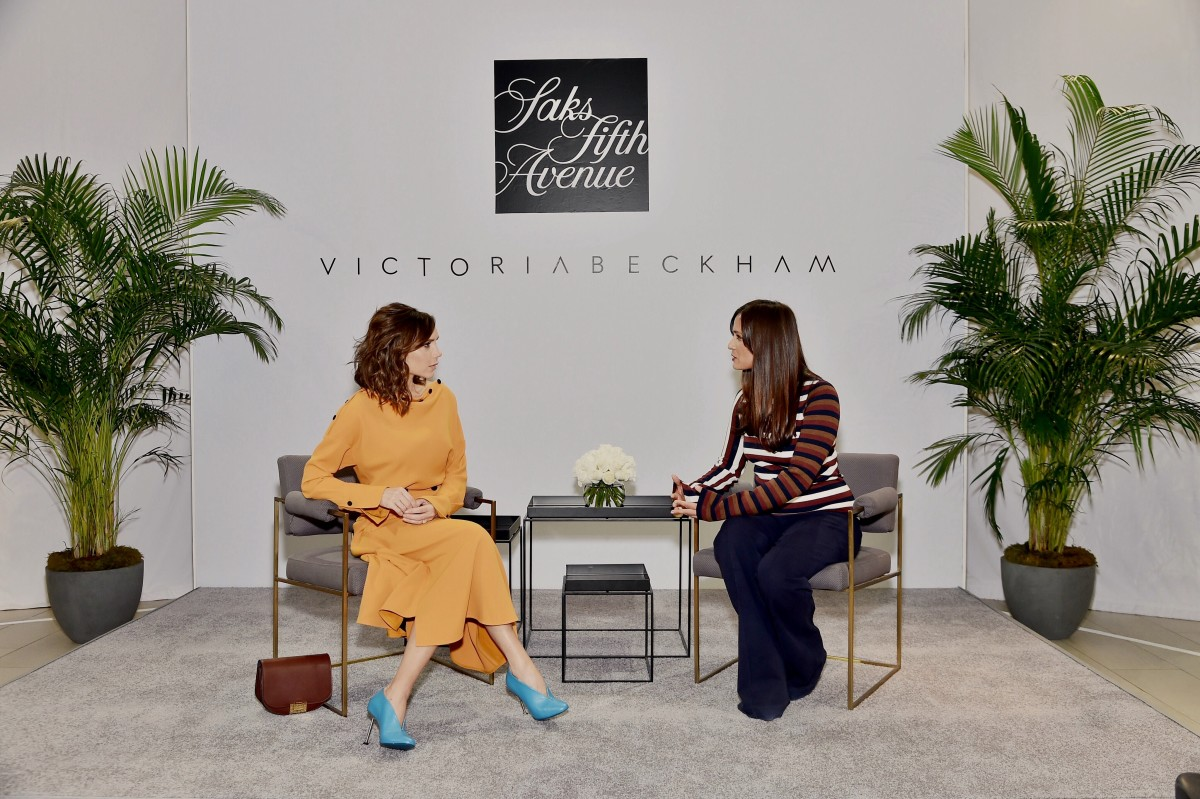 Victoria Beckham chats with Saks Fifth Avenue Fashion Director Roopal Patel at the Saks flagship location.  Photo: Mike Coppola/Getty Images