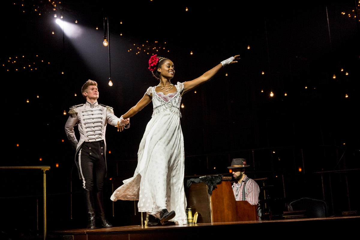 Lucas Steele and Denée Benton in 'Natasha, Pierre and the Great Comet of 1812.' Costume designer Paloma Young also incorporated mod silhouette details inspired by the 1960s/'Camelot'-referential set design by Mimi Lien. -Photo: Chad Batka