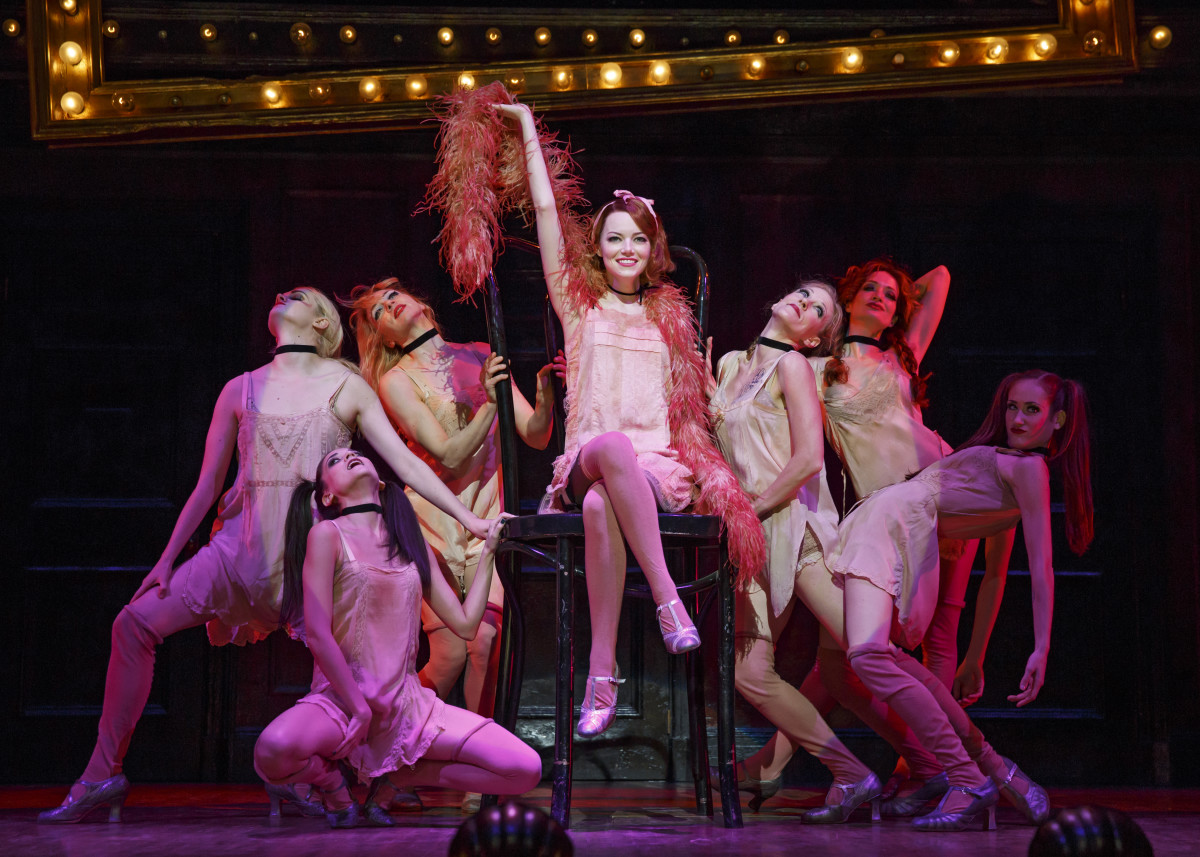 Emma Stone as Sally Bowles and company wearing costumes by William Ivey Long in 'Cabaret'. Photo: Joan Marcus