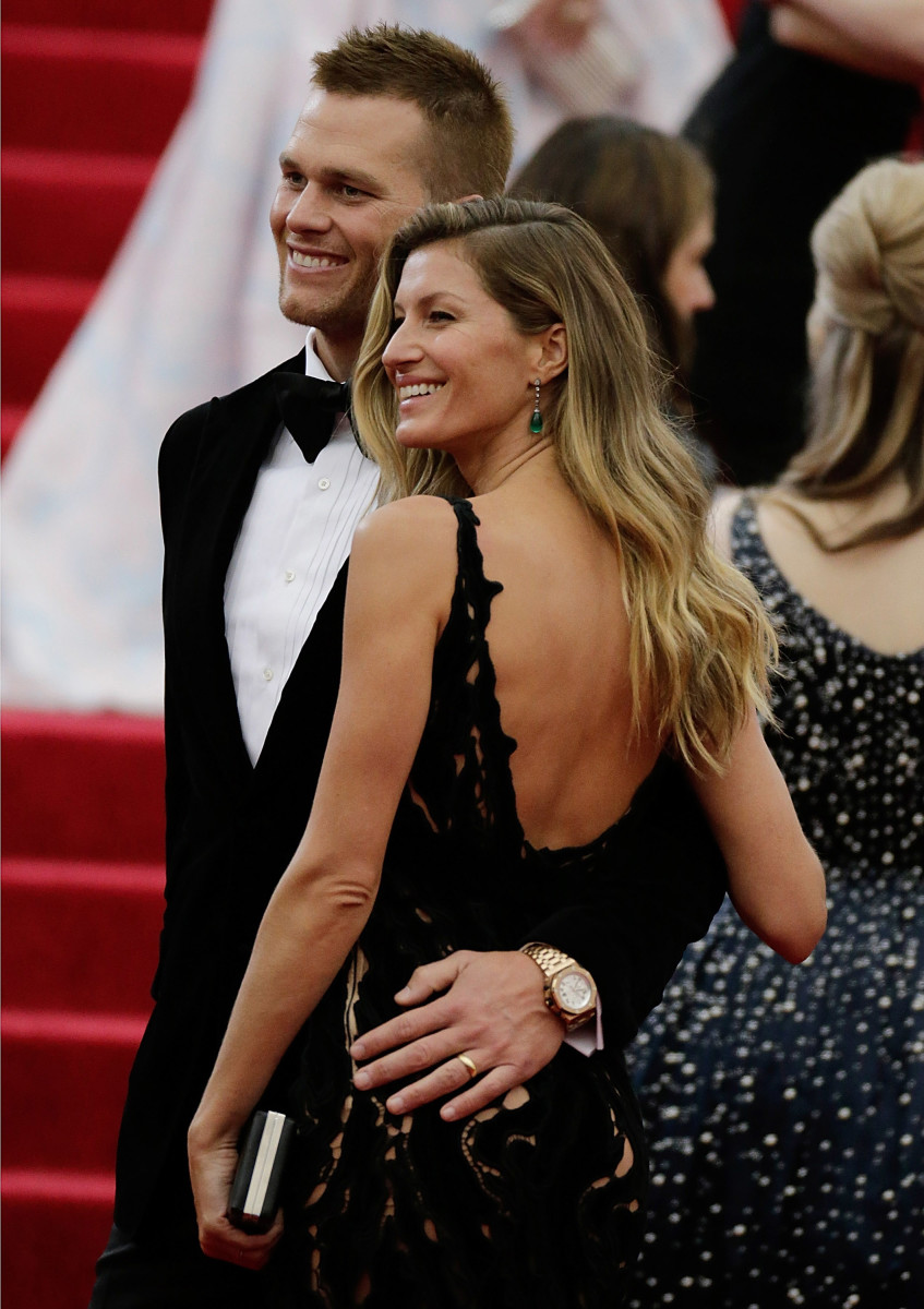 """Gisele Bündchen and Tom Brady at the """"Charles James: Beyond Fashion"""" Costume Institute Gala at the Metropolitan Museum of Art on May 5, 2014. Photo: John Lamparski/Getty Images"""