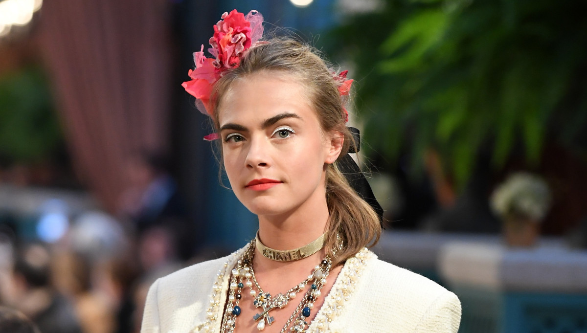 Cara Delevingne walks the Chanel Cosmopolite runway. Photo: Pascal Le Segretain/Getty Images