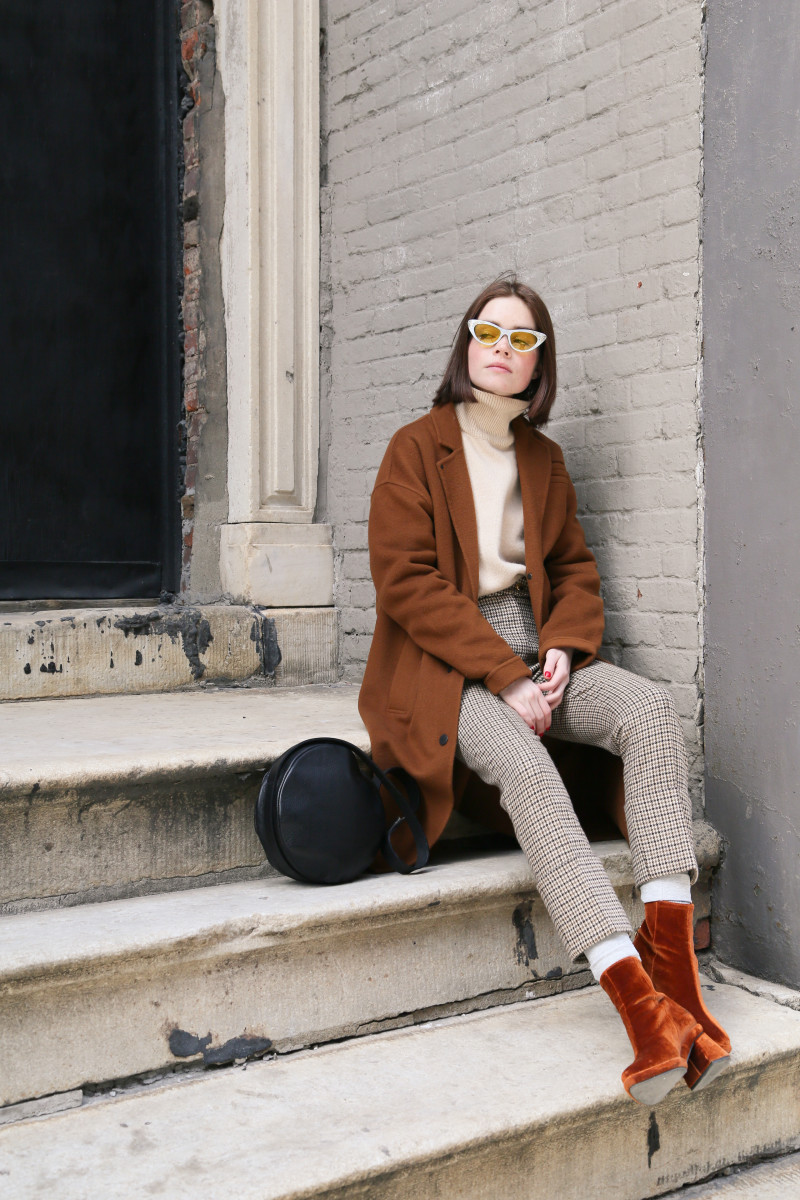 Reese Blutstein wearing The Arrivals coat, The Frankie Shop sweater, Nanushka pants, Reike Nen boots, Gucci glasses and a Sonya Lee purse. Photo: Whitney Bauck/Fashionista