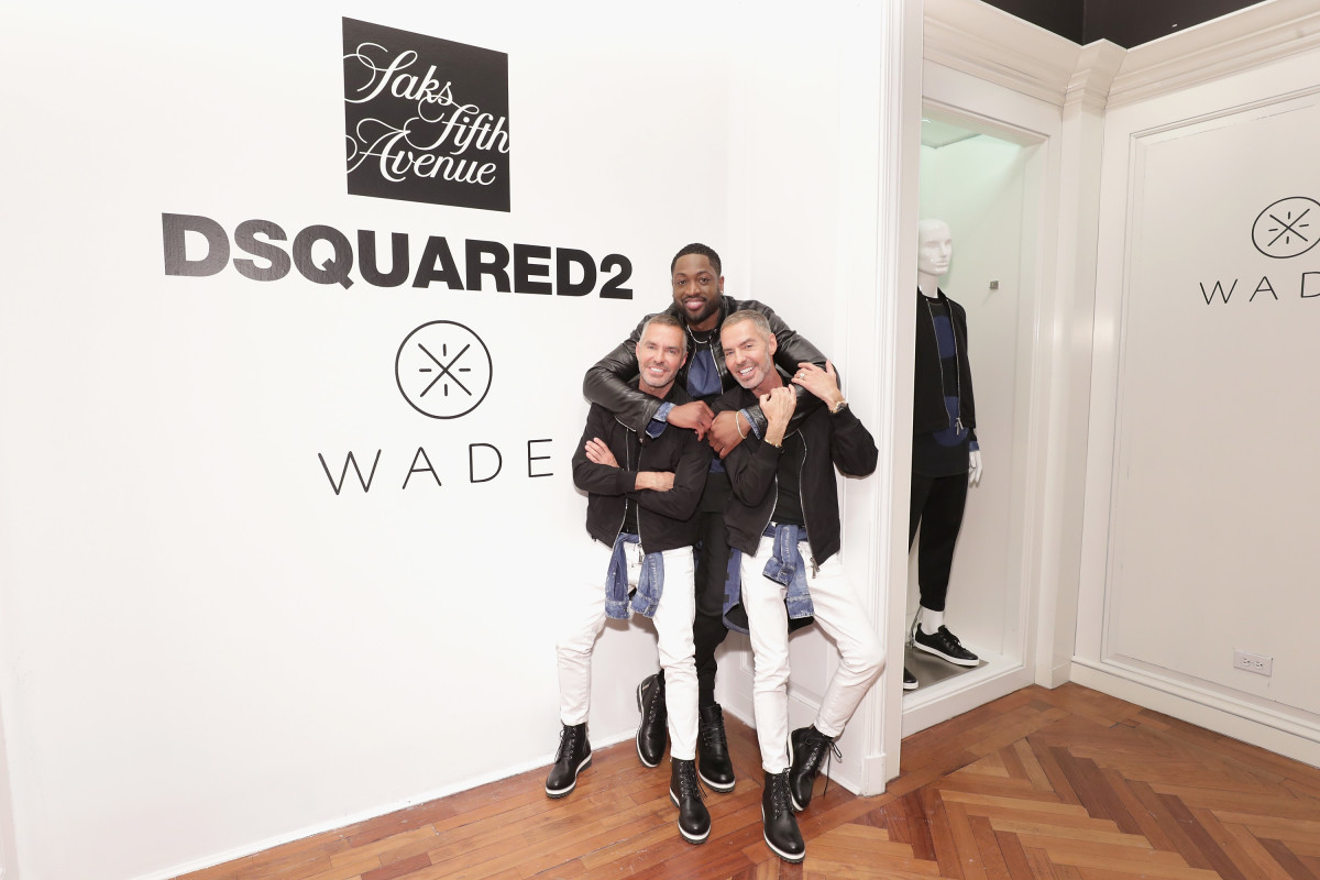 Dean Caten, Dwyane Wade and Dan Caten hug it out. Photo: Getty for Saks Fifth Avenue
