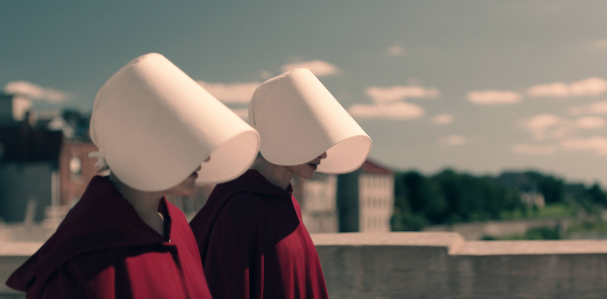 Offred (left) and Offglen (Alexis Bledel, right) wear their capes differently. Photo: Take Five/Hulu
