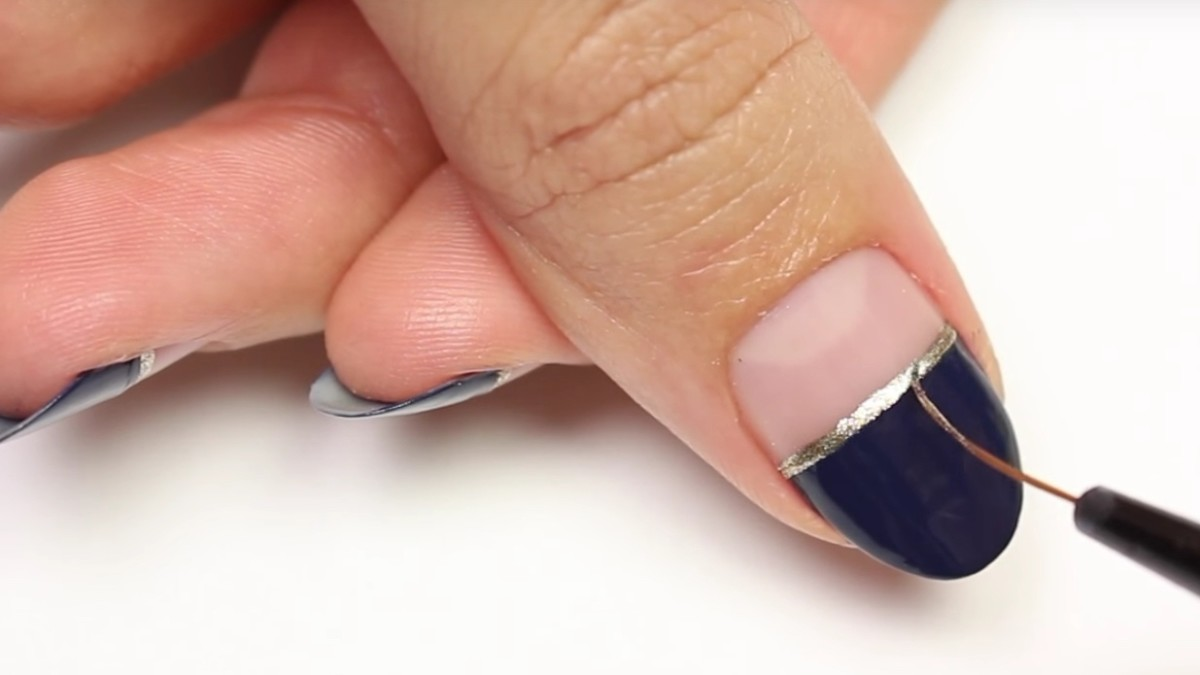 A pretty negative-space manicure to try this weekend. Photo: HannahRoxNails/YouTube