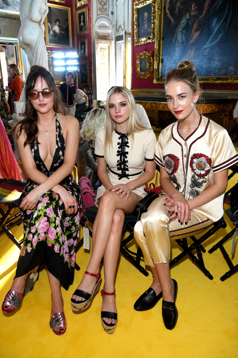Dakota Johnson, Stella Banderas-Griffith and Grace Johnson at Gucci's Cruise 2018 show. Photo: Venturelli/Getty Images